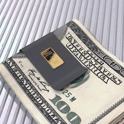 A one (1) Gram .9999 Credit Suisse Pure Gold Ingot mounted on NASA Optical Gray Titanium money clip.  CUSTOM ORDER - Ships in approx. 2 to 3 weeks